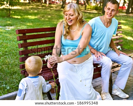 Pregnant woman  outdoor in park.