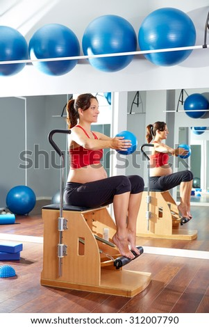 pregnant woman pilates leg pumps exercise on wunda chair