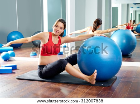 pregnant woman pilates saw exercise workout at gym indoor