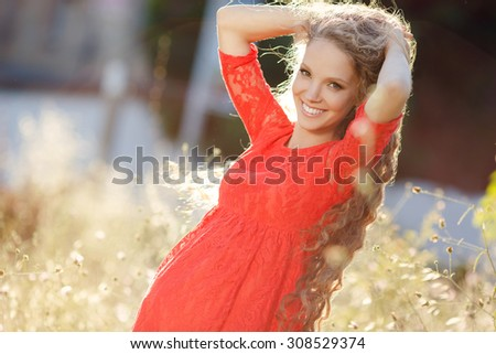 Pregnant woman posing in yellow dry grass. young happy pregnant woman relaxing and enjoying life in nature - stock photo