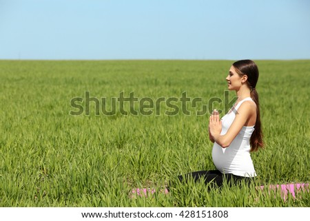 Pregnant woman practicing yoga pose