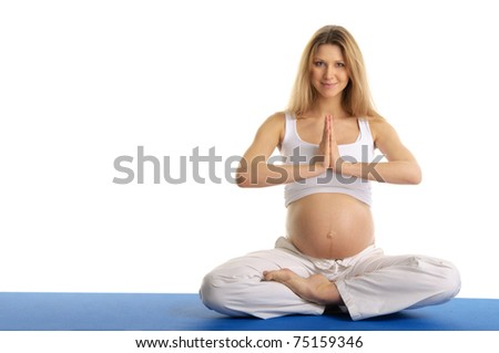 Pregnant woman practicing yoga, sitting isolated on white - stock photo