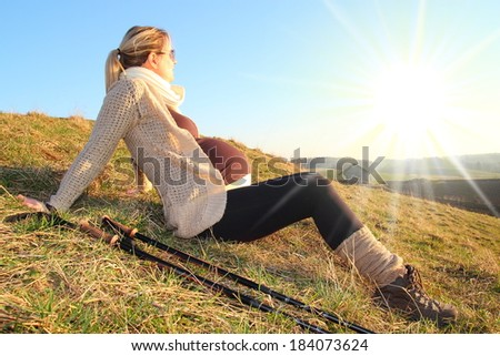 Pregnant woman rest in sunset - stock photo