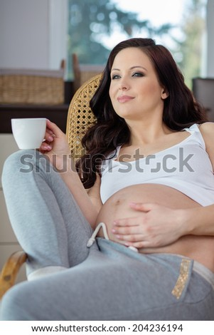 Pregnant woman resting at home