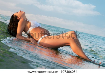 Pregnant woman resting at the seaside - stock photo