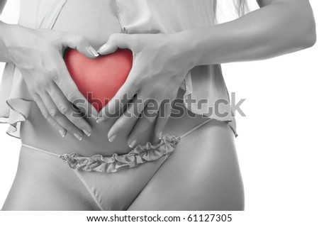Pregnant woman showing heart sign on her belly