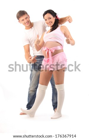 pregnant woman showing thumbs up and her husband picking on her belly isolated on white