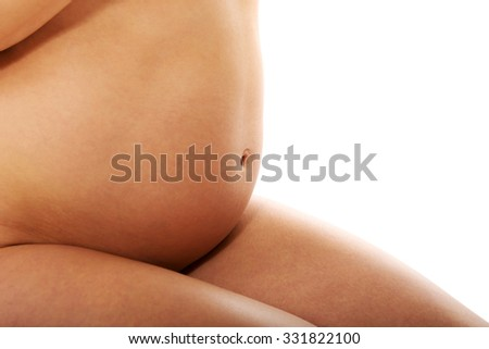 Pregnant woman sitting on knees