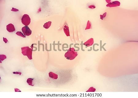 Pregnant woman taking spa bath