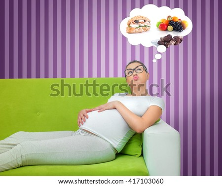 Pregnant woman thinking about food. Hungry expectant mother lying on the couch.