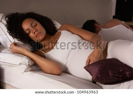 Pregnant woman trying to sleep