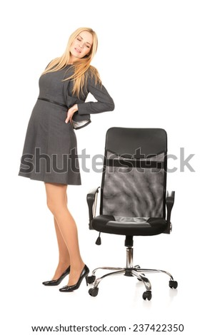 Pregnant woman with back pain because of long working - stock photo