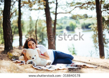 Pregnant woman with bear