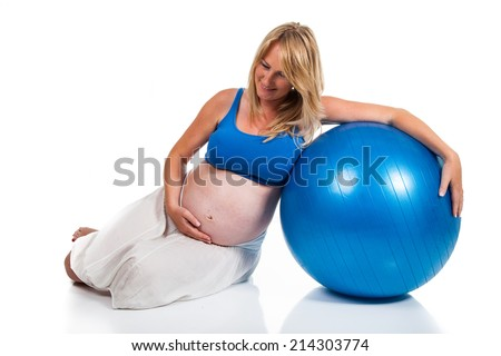 Pregnant woman with blue ball - stock photo