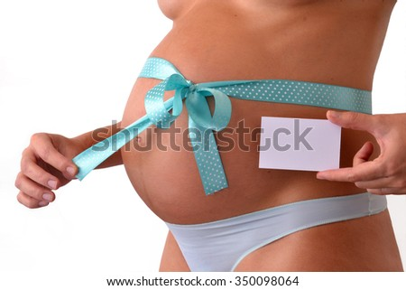 Pregnant woman with blue loop on her belly holding a White card panel.