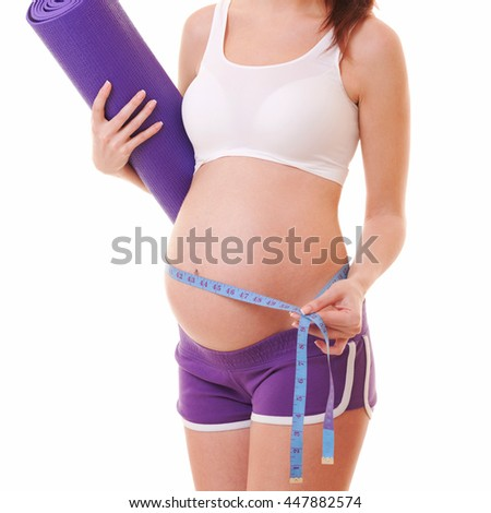 pregnant woman with exercising mat and measure tape on the white background