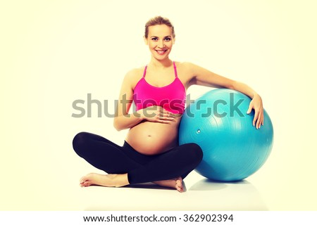 Pregnant woman with gymnastic ball - stock photo