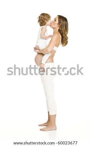 Pregnant woman with her daughter isolated on white background