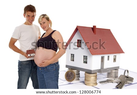 pregnant woman with her man and a small house / future plans