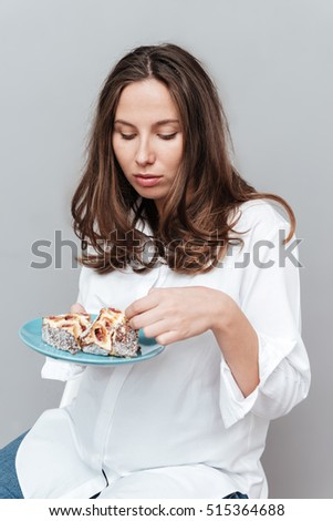 Pregnant woman with pie. isolated gray background