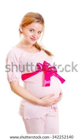 Pregnant woman with red bow on the belly on a white background - stock photo