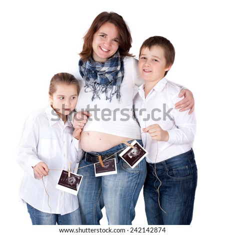 Pregnant women with children holding ultrasonic baby shot