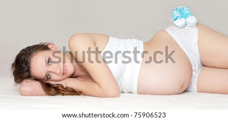 Pregnant Young Mother resting - stock photo