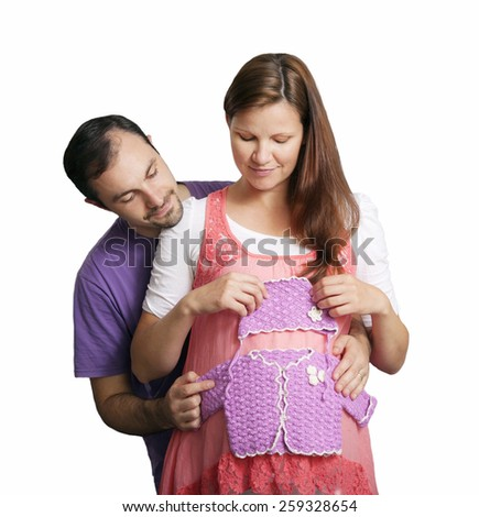 Pregnant young woman with her husband on the white - stock photo