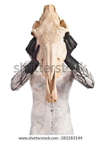 prehistoric man with horse skull - stock photo