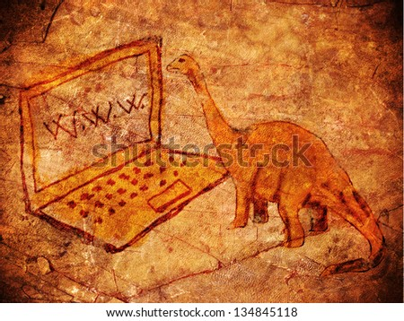 prehistoric petroglyph with computer and dinosaur - stock photo