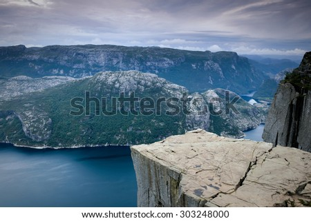 Preikestolen massive cliff in fjord Lysefjord in Norway. Pulpit rock  - stock photo