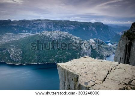 Preikestolen massive cliff in fjord Lysefjord in Norway. Pulpit rock  - stock photo