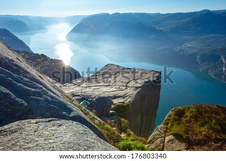 Preikestolen massive cliff (Norway, Lysefjorden summer morning view) - stock photo