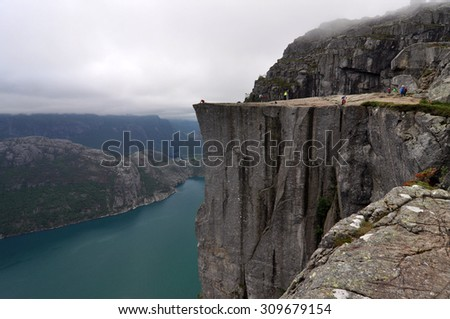 Preikestolen 3 Preikestolen or Prekestolen, also known by the English translations of Preacher's Pulpit or Pulpit Rock, is a famous tourist attraction in Forsand, Ryfylke, Norway. - stock photo