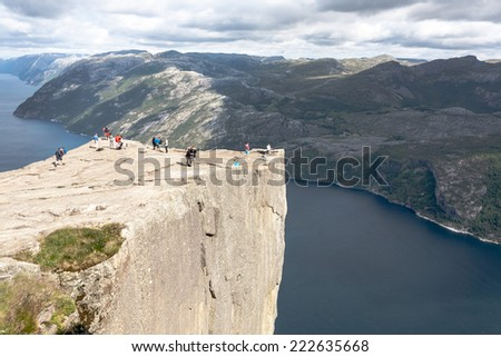 Preikestolen,Pulpit Rock at Lysefjorden (Norway). A well known tourist attraction - stock photo