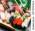 Premium quality sushi rolls served in Japanese restaurant. Asian food background - stock photo