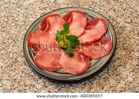 Premium raw japanese tongue beef sliced on plate
