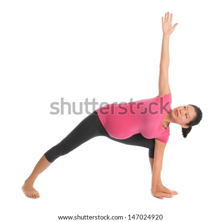 Prenatal yoga class. Full length healthy Asian pregnant woman doing yoga exercise stretching at home, full body isolated on white background. Yoga positions side stretch. - stock photo