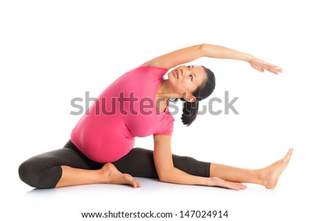 Prenatal yoga. Full length Asian pregnant woman doing yoga exercising stretching, full body isolated on white background. - stock photo