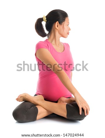 Prenatal yoga. Full length Calm Asian pregnant woman doing yoga exercising stretching, full body isolated on white background. - stock photo