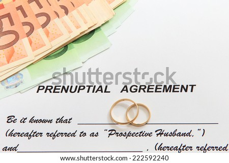 Prenuptial Agreement with glasses wedding rings and euro notes - stock photo