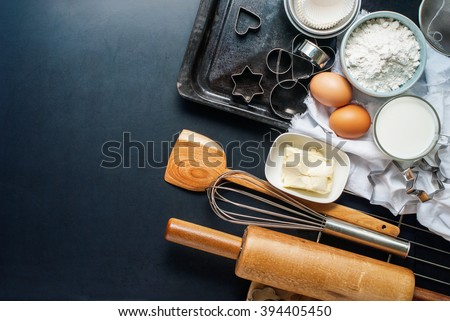 Preparation Baking Accessories Kitchen Composition Black Table Top Wooden Metal Dishes Table Ware Fresh Grocery Different Support Stuff - stock photo