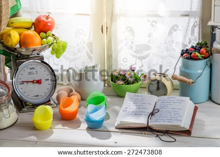 Preparation for delicious cupcakes with blueberries - stock photo