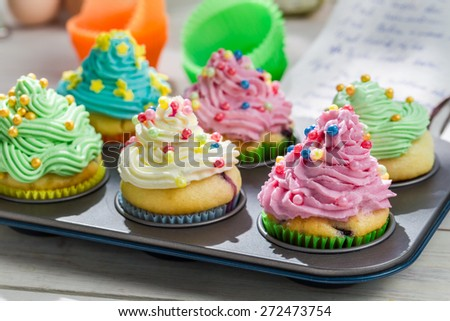 Preparation for delicious muffins with sweet cream - stock photo