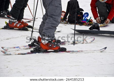Preparation for descent from the mountain. Alpine skiing equipment.