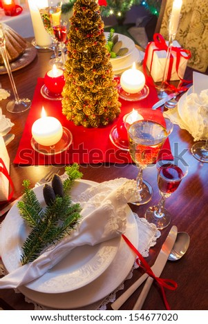 Preparation for dinner at Christmas table - stock photo