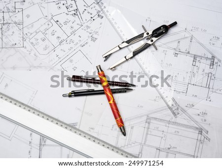 Preparation for drafting papers, the tools and schemes on the table. - stock photo