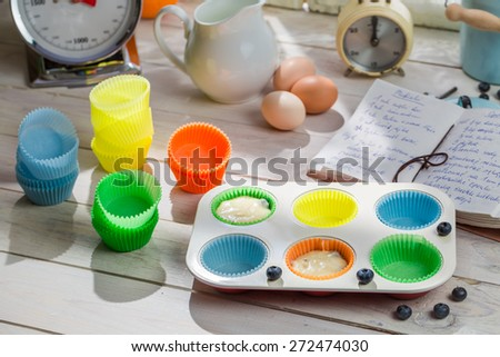 Preparation for sweet cupcakes with berry fruits - stock photo