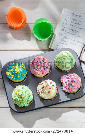 Preparation for sweet cupcakes with cream - stock photo