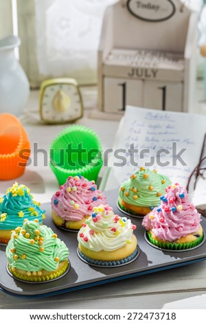 Preparation for sweet cupcakes with sweet cream - stock photo